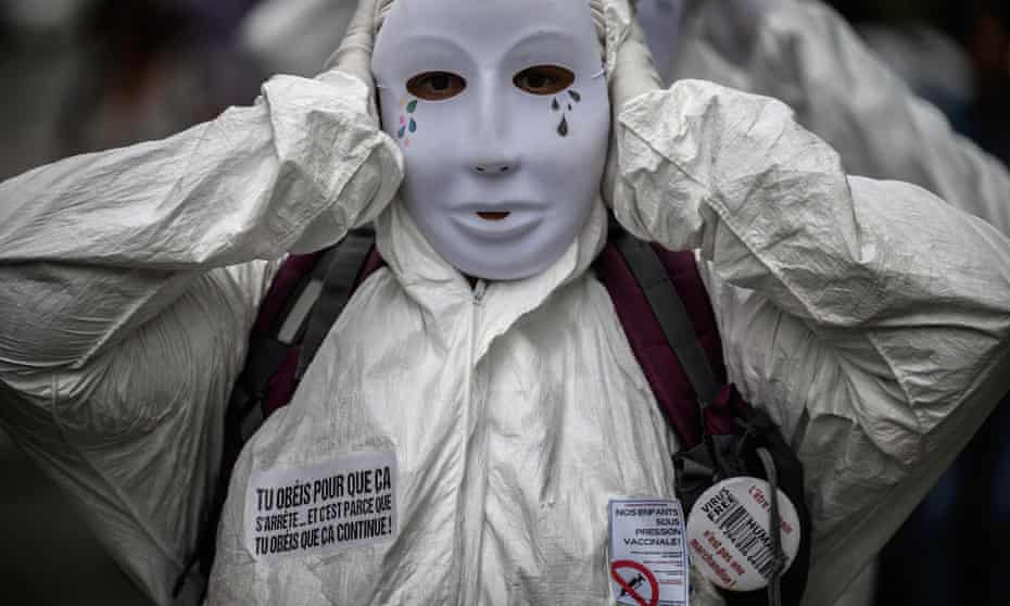 A protestor in a mask and personal protective equipment