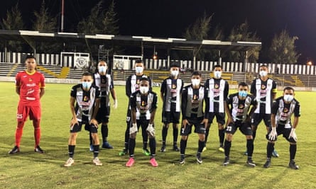 Diriangén's outfield players wear face masks, and in some cases gloves, before a game in Nicaragua.