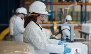 A worker at chemicals giant Ineos's new hand sanitiser plant at Newton Aycliffe, near Middlesbrough, which is to produce one million bottles a month.