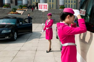 Hostesses wait for delegates in front of the Great Hall