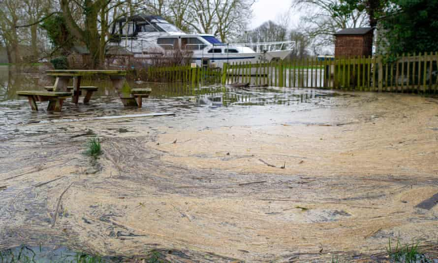 Pollution gathers in a flooded picnic area by the River Thames in Datchet earlier this year.