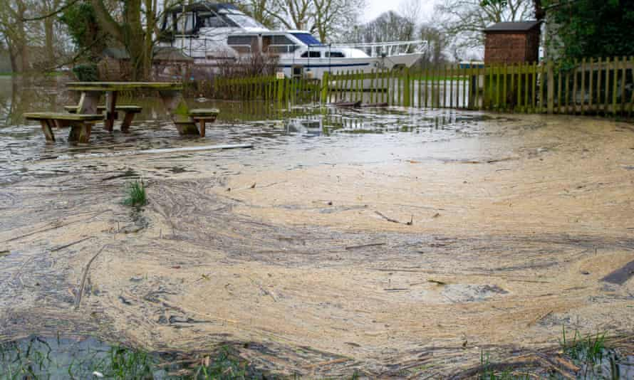 Pollution collects in a flooded picnic area by the River Thames in Datchet
