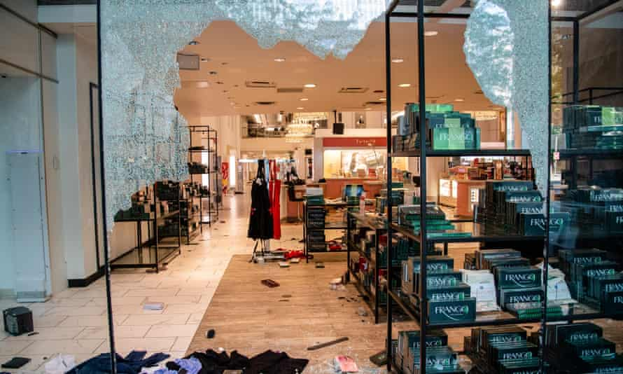 Broken windows are seen at a Macy's following a night of civil unrest and looting in downtown Chicago following the shooting of an Englewood man on Sunday.