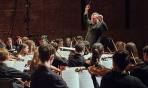Thomas Adès conducts the National Youth Orchestra of Great Britain at Snape Maltings concert hall, Aldeburgh.