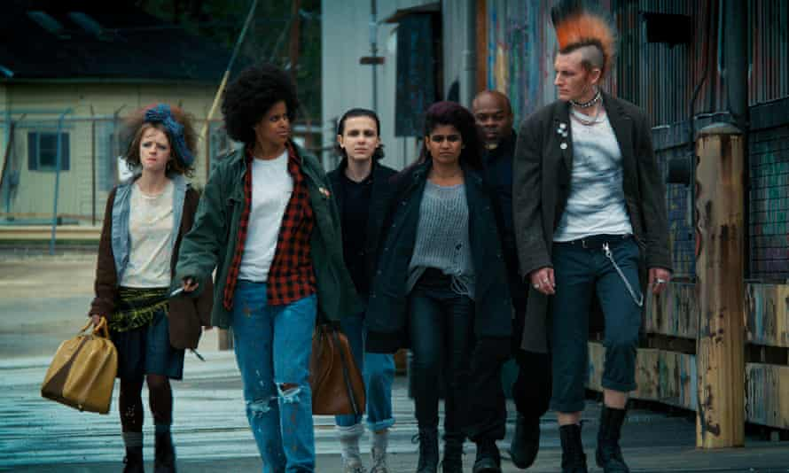 Eleven (third from left) goes punk in Stranger Things.