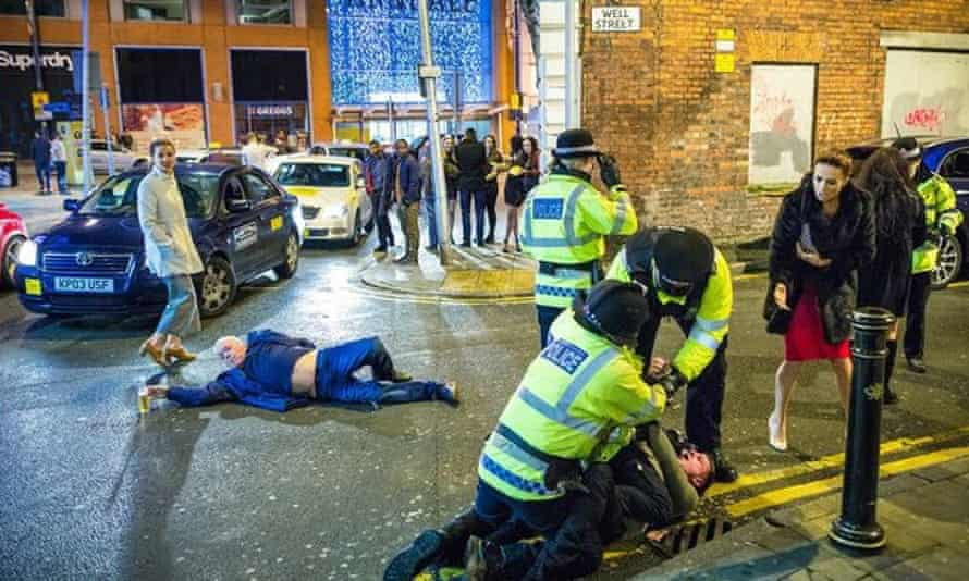 Joel Goodman's stunning image of New Year's Eve on Wells Street in Manchster, UK, 31 December 2015. The photograph, taken for the Manchester Evening News, has gone viral on social media, lauded as a 'perfect image'.