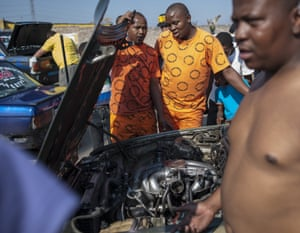 The Spirit Spirit crew assessing their car's engine after a round of spinning