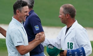 Justin Rose is congratulated by his caddie David Clark on the 18th green after finishing at seven under par.