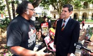 Adrian Burragubba of the Wangan and Jagalingou people talks to Queensland's Speaker, Peter Wellington, outside Parliament House in Brisbane