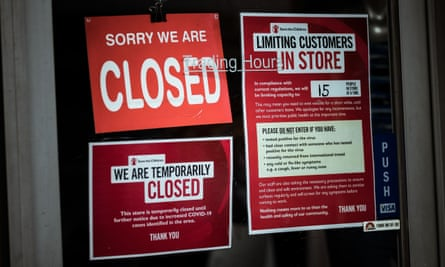 Shops on in Melbourne's Brunswick display signs informing customers of their closure on 5 August.