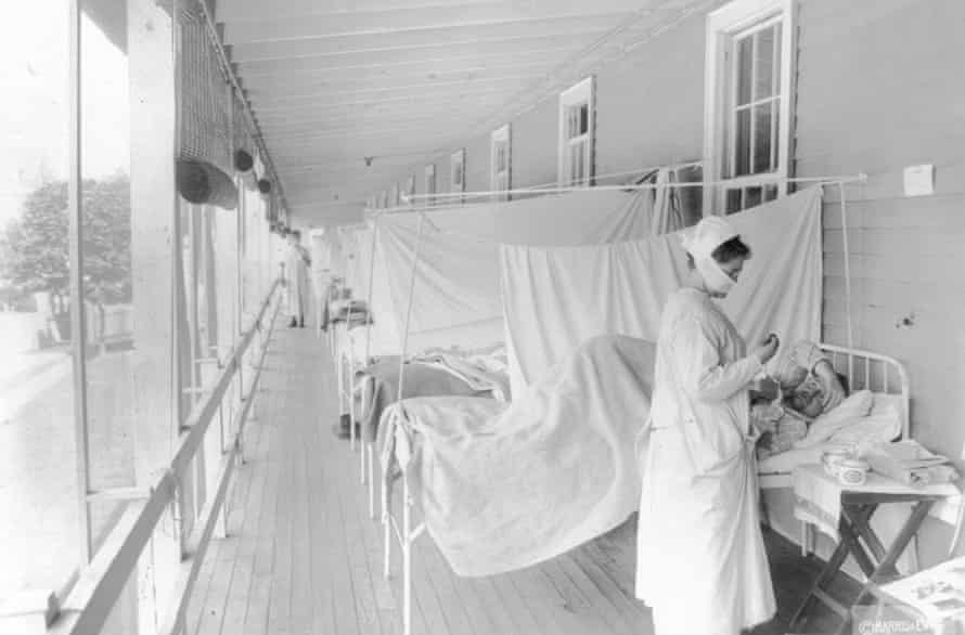 A nurse cares for a patient in the influenza ward of Walter Reed hospital in Washington in 1918.