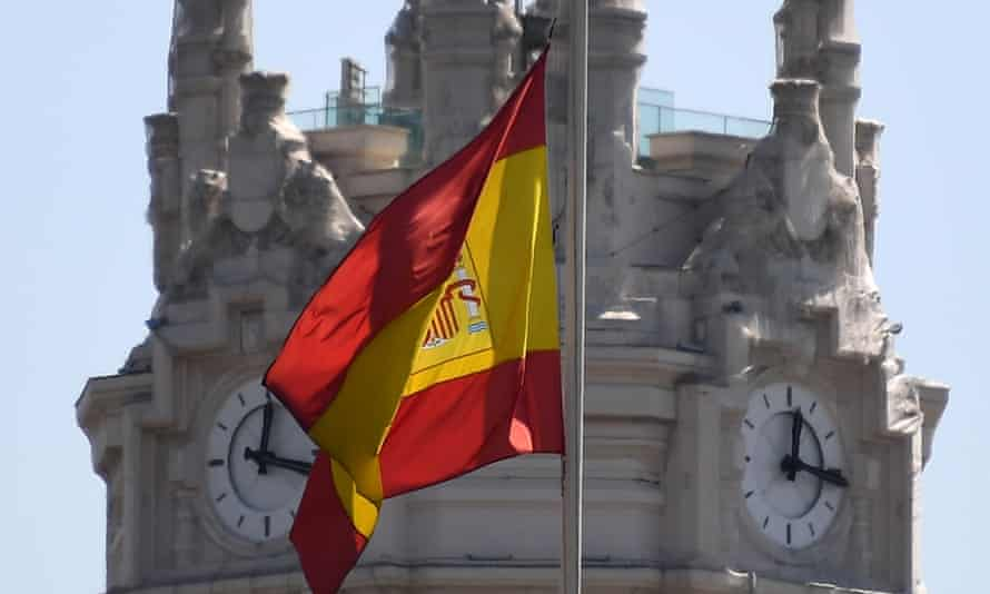 A Spanish flag at half-mast in front of Cibeles Palace in Madrid