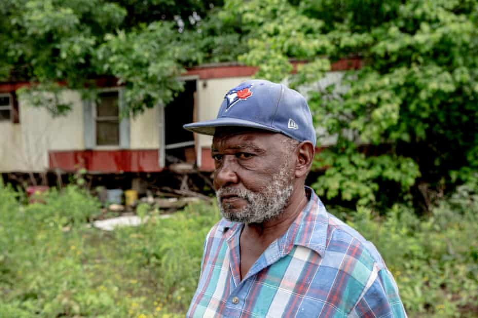 Walter Coats stands near his trailer, where he has lived for over 50 years.