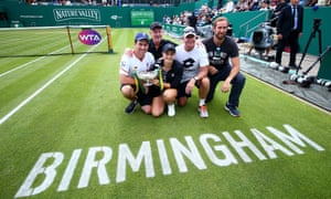 Ashleigh Barty takes time for a photo with her team after winning the Nature Valley Classic in Birmingham last week.