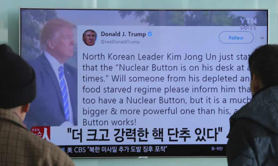Koreans at Seoul railway station watch TV reports of Donald Trump's latest Twitter spat with Kim Jong-un.