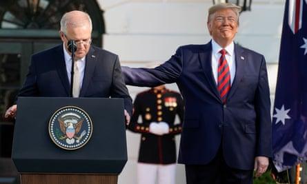 Donald Trump pats Scott Morrison on the back