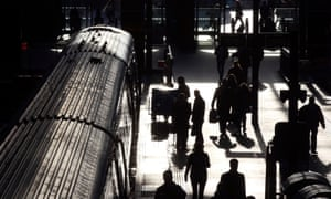Passengers board a train at King's Cross station in London