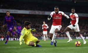 Alexandre Lacazette takes on Liverpool's goalkeeper Alisson before doubling back and firing in Arsenal's equaliser.