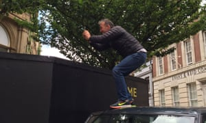 Flm-maker Nick Broomfield confronts the barrier around Cardiff's Coal Exchange.