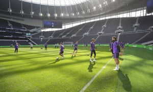 Spurs players take training inside the club's new stadium for the first time.