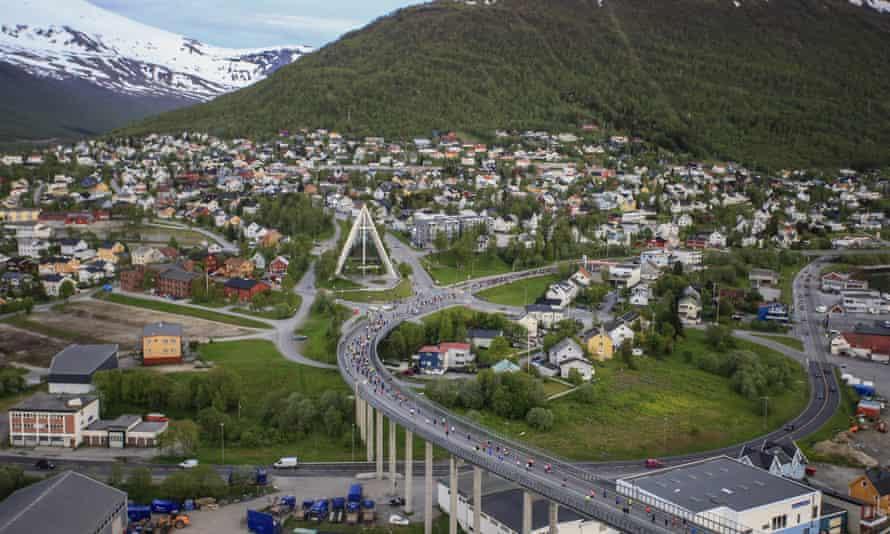 Runners on the Midnight Sun Marathon cross Tromsø Bridge.