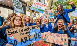 Young people on a climate strike in London in 2019 organised by Extinction Rebellion and other groups campaigning for the environment