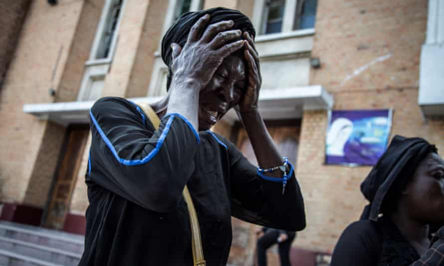 A woman mourns the death of a relative who was killed in the New Year's Eve protests.
