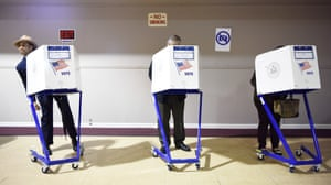 Voters fill in their ballots at a polling station in Staten Island of New York, the United States,