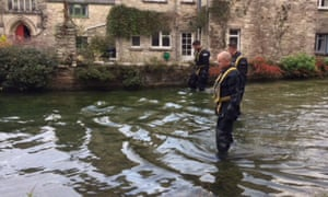 A police team searches a mill pond in Swanage, Dorset, after 19-year-old Gaia Pope disappeared a week ago.