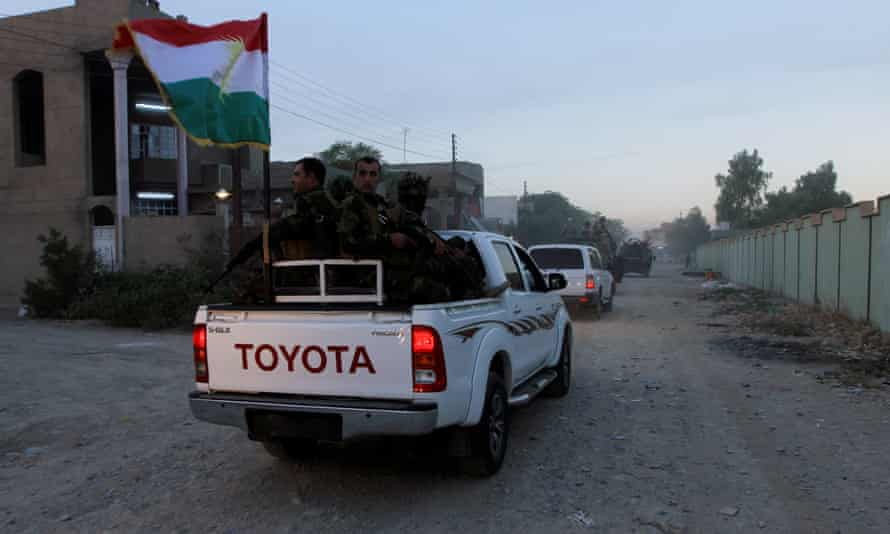 Iraqi Kurdish security forces patrol a street in the city of Kirkuk.