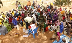 People rescued from Boko Haram wait for medical treatment at a camp near Mubi in north-east Nigeria.
