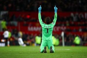 Liverpool goalkeeper Alisson celebrates after Adam Lallana's late equaliser