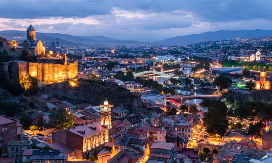 View of Tbilisi's Old Town and Narikala Fortress at dusk, Georgia.