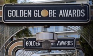 Signs for the 77th annual Golden Globe awards hang over the red carpet