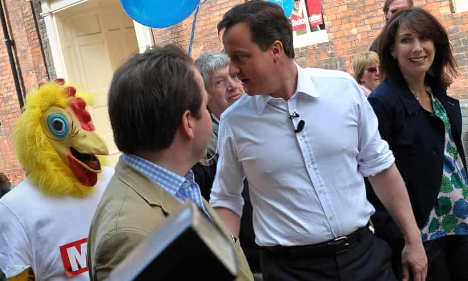 The Daily Mirror Chicken accosts David Cameron and his wife Samantha in 2010.