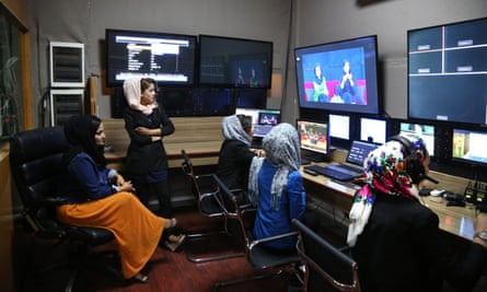 Producers in the editing room of Afghanistan's first women's TV channel, Zan TV