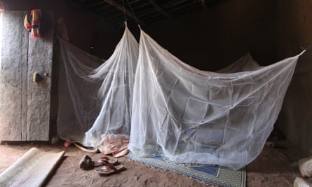 A bed net is seen hanging up in a living space in Burkina Faso