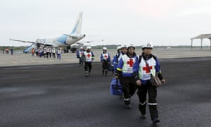Red Cross members arrive at Eloy Alfaro airport after an earthquake struck off Ecuador's Pacific coast