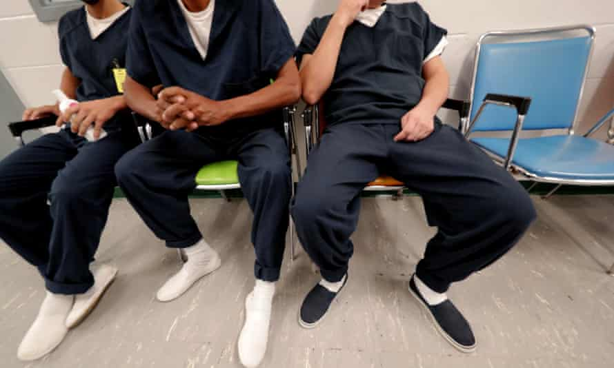 Detainees sit and wait for their turn at the medical clinic at the Winn correctional center.