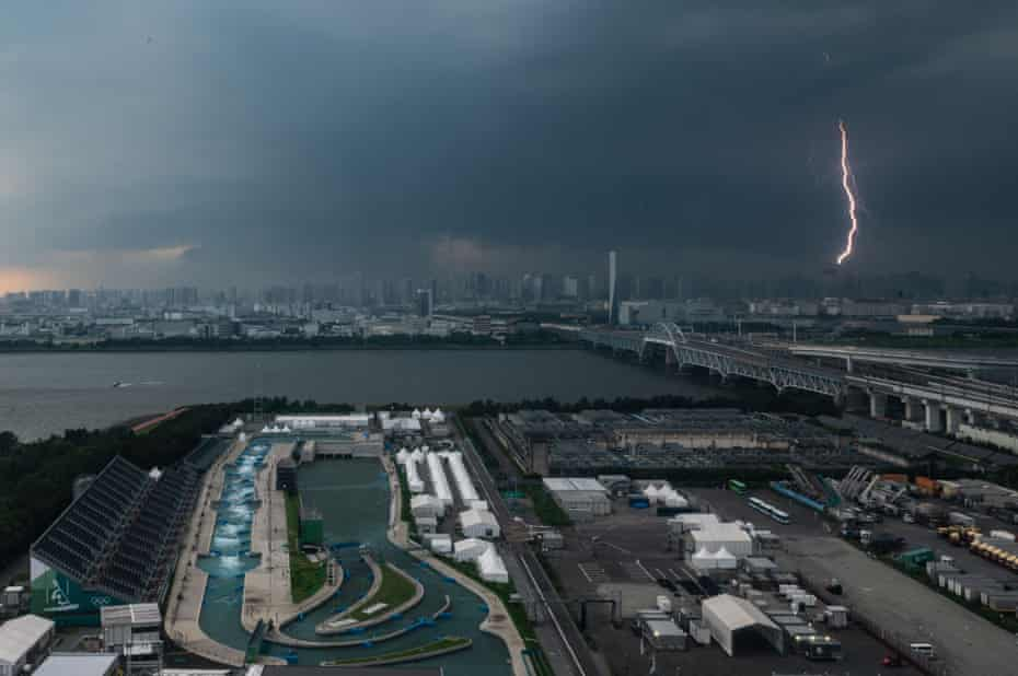 A bolt of lightning is seen in the background past the Kasai canoe slalom centre in Tokyo.