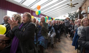 Supporters applaud as Plaid Cymru leader Leanne Wood speaks at her party's campaign launch in Bangor.
