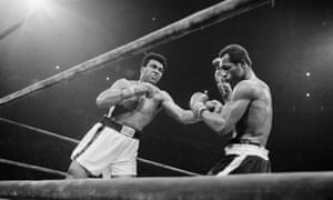 Muhammad Ali punches Ken Norton in the face