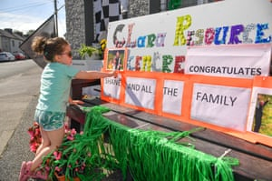 Ellie Nolan of Killeigh, Co. Offaly checks out the sign congratulating Lowry outside a Clara resource centre