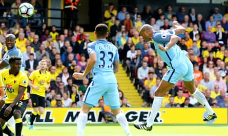 Vincent Kompany heads Manchester City in front in the fifth minute against Watford