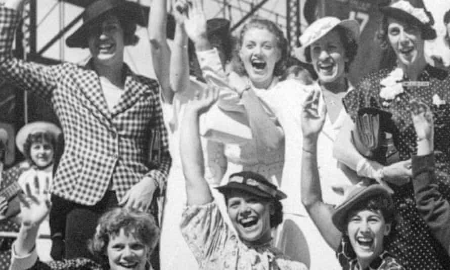 Simone Schaller, lower right, waves with members of the US women's Olympic track and field team as they depart for Europe on the SS Manhattan in 1936.