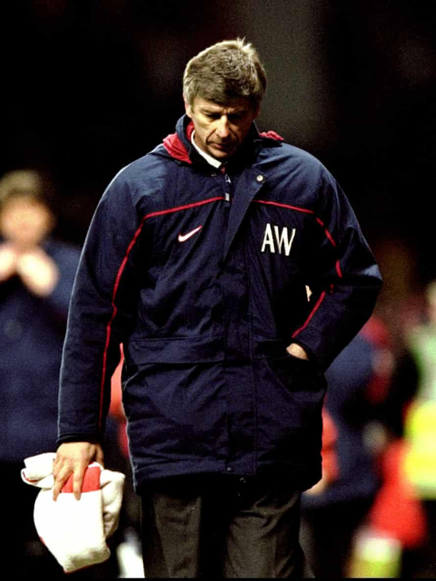 A disappointed Arsène Wenger trudges off after defeat.