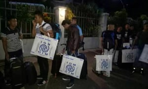 Refugees accepted for resettlement in the US line up for a bus to Port Moresby airport. Most have been held in Australia's offshore immigration regime on Manus Island for more than four years.