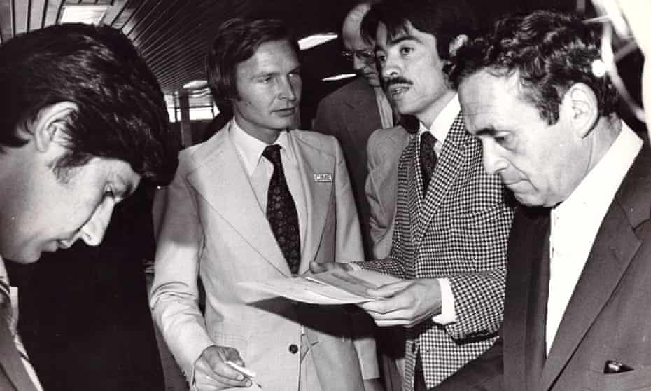 Roberto Kozak, at the airport, helps a rebel leader catch a plane into into exile.