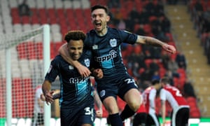 Bury's attacking football has received plenty of praise thanks to the work of striker Nicky Maynard, left, and Jay O'Shea, right.