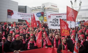 Porsche employees in the metalworkers' union IG Metall demonstrate for the right to a 28-hour working week with a limited loss of salary.